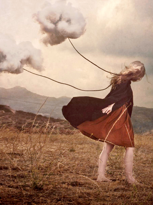 Jeune fille tirant deux nuages